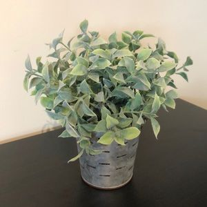 Faux plant in metal pail